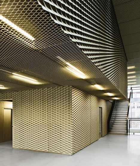 4d4b0b84c4f6860dbf48139aabbfe135--metal-cladding-wall-cladding cobe library.jpg