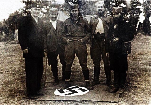 Četnici_stoje_na_zastavi_nacističke_Nemačke.jpeg