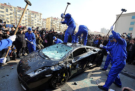 Lamborghini-Gallardo-hammered-to-death-in-protest.jpg